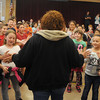 Globe/Roger Nomer<br /> Stapleton Elementary students welcome back custodian Lourdes Hasty on Monday morning as she returns to work at the school.