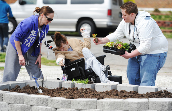 Globe/T. Rob Brown<br /> Amanda Heeren (right), of Joplin, residential coordinator with Community Support Services, gets consumer Alaina Weideman's opinion on a gardening choice Saturday, April 20, 2013, as primary advocate Shanon Seward (left), of Joplin, looks on at the new CSS garden, 23rd Street and Annie Baxter in Joplin. The garden is a joint project of CSS and Joplin Elks Lodge 501.