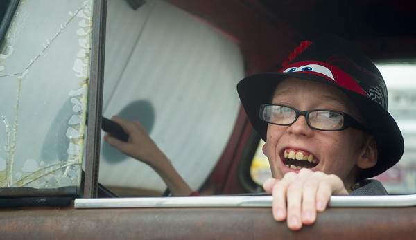 Globe/Roger Nomer<br /> Andy Shepherd laughs from the drivers seat of Tow Tater during a visit to Galena on Wednesday afternoon.