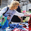 Globe/T. Rob Brown<br /> Opal Ward of Braggs, Okla., looks through a selection of clothes in the 600 block of Oak Ridge Drive in Neosho during the citywide garage sale Friday afternoon, April 5, 2013. Ward said her sister lives in Carl Junction and they like to come look at all the good deals.