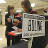 Globe/Roger Nomer<br /> Participants in Tuesday's poverty simulation adapted the persona of a family facing the challenges of poverty, down to their names and address at Pittsburg's Memorial Auditorium.