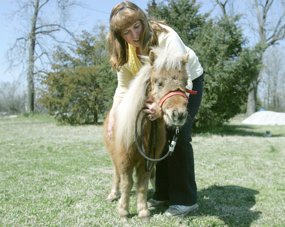Globe/Roger Nomer<br /> Bridget Kavanaugh pets her miniature Tonka, who she is offering to be trained as a therapy horse.
