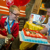 Globe/Roger Nomer<br /> Andy Shepherd looks at a cake presented to him by Marla Gourley, a wish fulfiller with Make A Wish, on Wednesday afternoon at the Streetcar Station Coffee Shop.