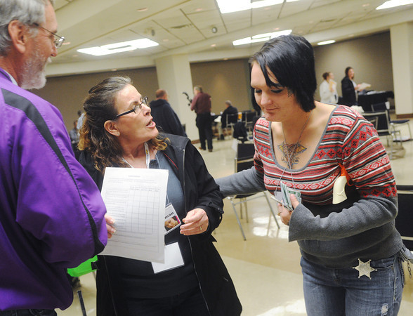 Globe/Roger Nomer<br /> Kim Norris, Erie, argues with with Debbi Hindon, Pittsburg, portraying a police officer, over her family's eviction during a poverty simulation at Tuesday's homeless summit at Pittsburg's Memorial Auditorium.