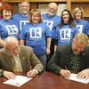 Globe/Roger Nomer<br /> Rep. Bill White and Rep. Charlie Davis, joined by local realtors, sign the Homeownership Matters to Missourians Pledge at the Ray McDaniel Conference Center on Friday morning.  The pledge advocates five points to advance homeownership in the state, including opposing overregulation of mortgage financing and ensuring the continued deductibility of real property taxes.