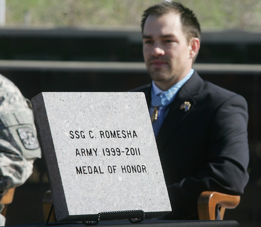 Globe/Roger Nomer<br /> former Staff Sergeant Clinton Romesha was honored with an engraved paver at the Pittsburg State Veteran's Memorial on Thursday.