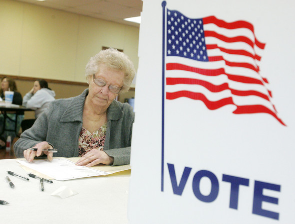 Globe/Roger Nomer<br /> Peggy Lyons fills out her ballot at the Baxter Springs Community Center on Tuesday afternoon.