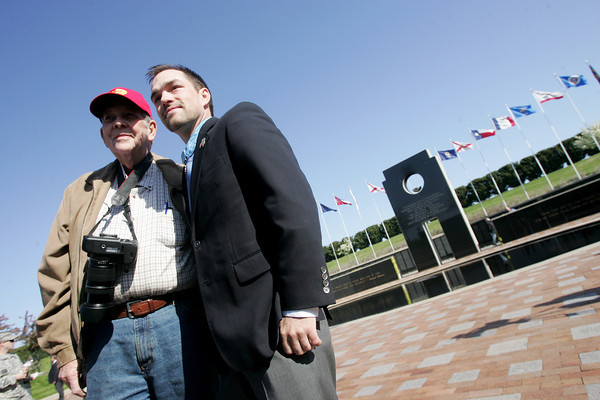 Globe/Roger Nomer<br /> former Staff Sergeant Clinton Romesha poses for a photo with Clinton Carter, Pittsburg, at the Pittsburg State Veteran's Memorial on Thursday.