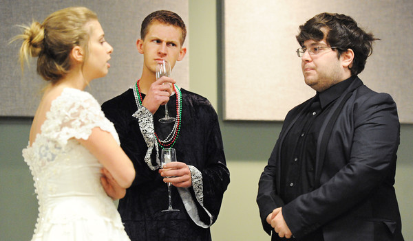 Globe/T. Rob Brown<br /> Joplin High School students perform a French skit where groom Joey Caphart, right, is confronted by his bride-to-be Bailey Hale after a pregnant woman shows up at their wedding claiming the child is the groom's during the language skit competitions Thursday morning, April 11, 2013, in Missouri Southern State University's Phelp's Theater in Billingsly Student Center for Foreign Language Field Day. Taylor Hughes portrays the priest, center.