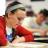 Globe/T. Rob Brown<br /> Senior Whitney Thomlinson reads over her assignment for a report Thursday morning, April 4, 2013, in Kate Ely's English class at East Newton High School.