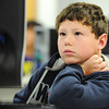 Globe/T. Rob Brown<br /> Josh Owens, a Granby Elementary School fourth grader from Kathryn Marion's class, reads a question while taking a Smarter Balance pilot test Thursday morning, April 4, 2013.