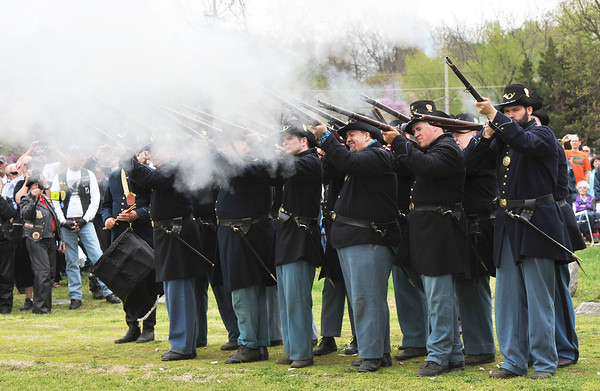 Members of The Holmes Brigade, a Civil War reenactment unit, fire a rifle salute for Major Raphael G. Rombauer during interment services on Saturday at Park Cemetery in CArthage.<br /> Globe | Laurie Sisk