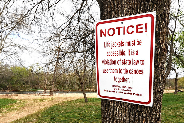 MIssouri State Water Patrol signs are nailed to a tree near Elk River at Big Elk Campground.<br /> Globe | Laurie Sisk