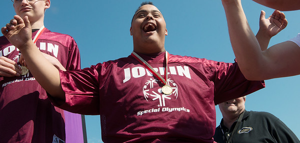 Globe/Roger Nomer<br /> Jacob Solomon, Joplin, celebrates his medal during Friday's Southwest Area Special Olympics Spring Games at Carl Junction High School.