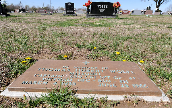 An empty grave at the Monett Cemetery sits near other family members' final resting places as a memorial to Valarie MIA Capt. Thomas Wolfe. Wolfe was shot down during the Vietnam War and friends and family are lobbying the government to increase its efforts to find his body.<br /> Courtesy photo