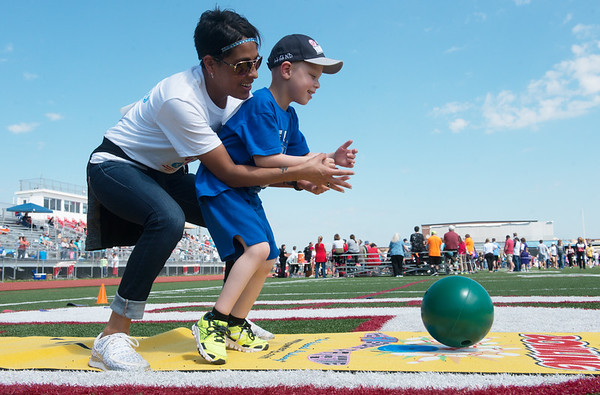 Globe/Roger Nomer<br /> Brittany Henderson helps her son Legend White, 6, Carthage, bowl during Friday's Southwest Area Special Olympics Spring Games at Carl Junction High School.