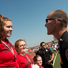 Globe/Roger Nomer<br /> Joplin Patrolman James Kelly congratulates Tabatha Griner, McDonald County, on her medal win during Friday's Southwest Area Special Olympics Spring Games at Carl Junction High School.