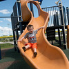 Globe/Roger Nomer<br /> Zebulon Simpson, 2, plays on a slide at the Will Norton Miracle Field on Wednesday afternoon.