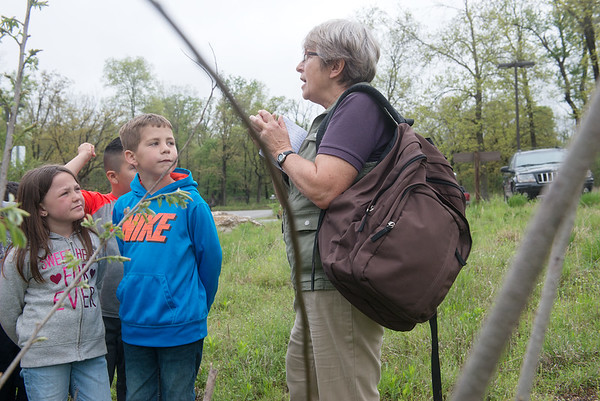 Globe/Roger Nomer<br /> Volunteer Val Frankoski leads Kelsey Norman first graders on a hike on Wednesday at the Wildcat Glades Conservation and Audubon Center.