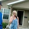 Globe/Roger Nomer<br /> Bree O'Haro talks with Joshua Grosvenor, a mechanical engineer with DNR, outside her house in Joplin on Tuesday morning.