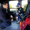 Six-year-old David Fonville gets an inside look at a Joplin Fire Department truck as JFD firefighter James Thomas assists during the YMCA's HEalthy Kids Day and 125th Anniversary celebration on Saturday at the YMCA South.<br /> Globe | Laurie Sisk