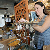 Natalie McClelland, owner of Sunkissed Earth, arranges her handmade eco-friendly jewelry during the Hip Handmade market on Saturday at the Roxy Event Center.<br /> Globe | Laurie Sisk