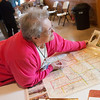 Globe/Roger Nomer<br /> Debye Harvey, co-owner of the Boots Court, looks at a map on Friday at the Jefferson Highway Convention at the Legacy Barn Event Center.