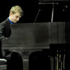 "Riley Remington, 12, performs ""Riley's Rhapsody"" for the judges during the Joplin Piano Teachers Association's 60th Annual Marie Guengerich Piano Festival on Friday at Forest Park Baptist Church. Remington has been studying piano for six years. The event continues Saturday with scores of local students taking to the stage.<br /> Globe 
