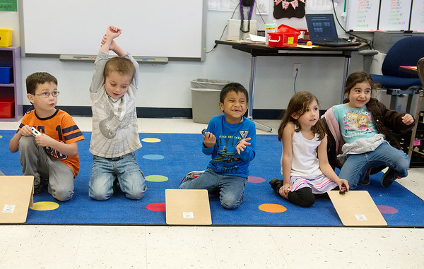 Globe/Roger Nomer<br /> Students race cars down ramps during a kindergarten science lesson conducted in Spanish on Monday at Fairview Elementary.