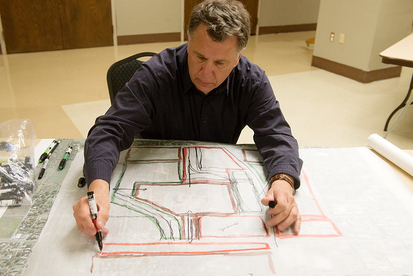 Globe/Roger Nomer<br /> Jere Tatich, a consultant with Elan, puts together a sketch of the proposed district during Tuesday's Open House for the Mid-City <br /> Renaissance Project at Pittsburg Memorial Hall.