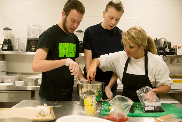 Globe/Roger Nomer<br /> (from left) Grant Carter, Carl Junction High School junior, Justin West, a homeschooled junior, and Shandra Kobler, Carl Junction senior, prepare their group's dish during Wednesday's competition at Franklin Tech.