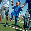 Globe/Roger Nomer<br /> Trinity Stanley, 9, Carthage makes a jump during Friday's Southwest Area Special Olympics Spring Games at Carl Junction High School.