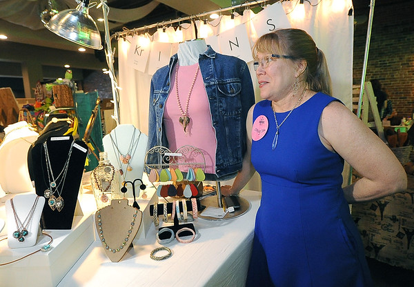 Artist Kristin Girard greets guests as she stands near some of her jewelry made from recycled materials on Saturday at the Hip Handmade Market.<br /> Globe | Laurie Sisk