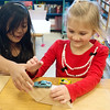Globe/Roger Nomer<br /> Kindergarten study buddies Natalie Guevara, left, and Campbell Kyte experiment with ramps during a science lesson conducted in Spanish on Monday at Fairview Elementary.