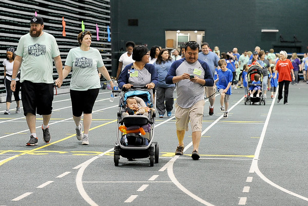 Scores of participants make the one-mile walk inside Leggett & Platt during the Ninth Annual Walk for Autism Awareness on Saturday at Missouri Southern.<br /> Globe | Laurie Sisk