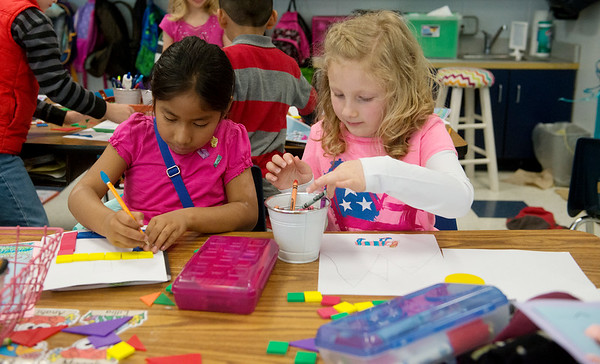Globe/Roger Nomer<br /> Fairview first graders Brecklyn Abbiatti, right, and Anahi Tistog Villagres are study buddies in the dual language class.