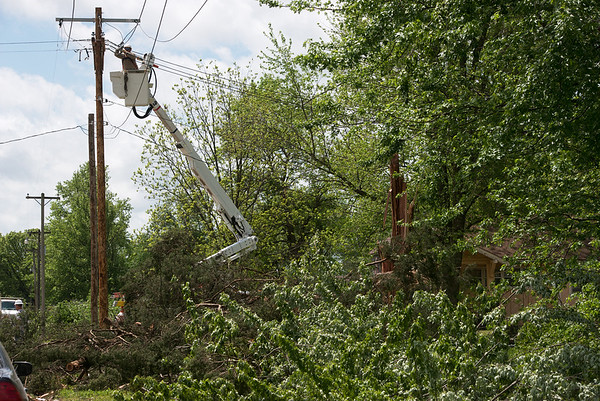 Globe/Roger Nomer<br /> Crews work to restore power in Girard on Wednesday morning.