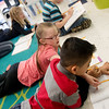 Globe/Roger Nomer<br /> Peyton Osmon helps Wilfido DeLeon-Vinac with an assignments in the Fairview Elementary first grade class on Monday.