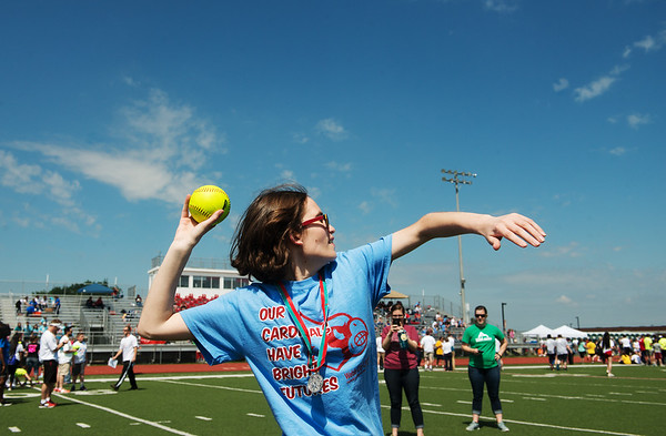Globe/Roger Nomer<br /> Hannah Nelson, Webb City, competes in the softball throw during Friday's Southwest Area Special Olympics Spring Games at Carl Junction High School.
