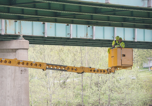 Globe/Roger Nomer<br /> A MODOT crew examines an I-44 bridge over Shoal Creek on Wednesday morning.