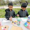 From the left: Trey Cruzat, 9 and Andres Cruzt, 6, of San Francisco,  join in activities during National Junior Ranger Day on Saturday at George Washington Carver National Park. The brothers are on a nationwide tour of the country's national parks, with a goal of visiting at least 25 percent of the parks with their parents before they are through. Saturday's visit marked the 62nd of the 102 parks on their list. <br /> Globe | Laurie Sisk