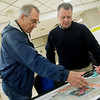 Globe/Roger Nomer<br /> John Martel, left, chats with Rob Holzman, senior project manager for Elan, during Tuesday's Open House for the Mid-City <br /> Renaissance Project at Pittsburg Memorial Hall.