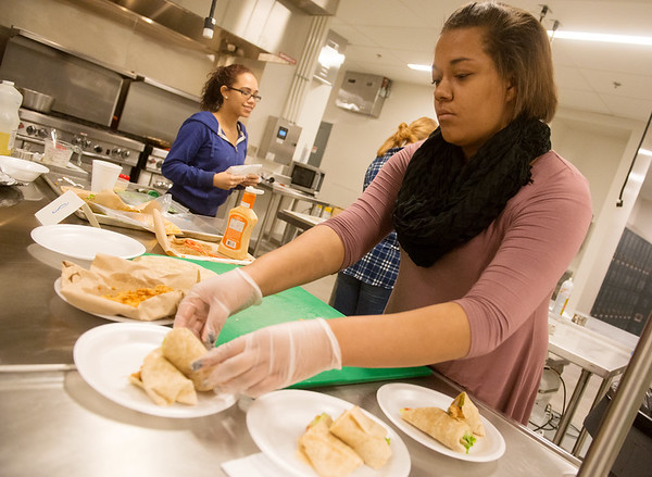 Globe/Roger Nomer<br /> Deja Johnson, a Joplin High junior, plates her group's wraps during Wednesday's competition at Franklin Tech.