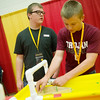 Globe/Roger Nomer<br /> Garrett Newberry, left, a senior at Girard High School, and Mitch Murphy, sophomore, prepare their boat for competition during the Gorilla Games on Tuesday at the Weede Physical Education Building at Pittsburg State University.