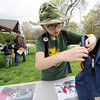 Ten-year-old Ian Suzuki adds yet another Junior Ranger badge to his backpack during NAtional Junior Ranger Day on Saturday at George Washington Carver National Park.<br /> Globe | Laurie Sisk