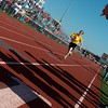 Globe/Roger Nomer<br /> Teagan Farriester, 12, Neosho, charges toward the finish line during a relay race during Friday's Southwest Area Special Olympics Spring Games at Carl Junction High School.
