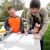 Hunter Brewster, 6, Kaylee Brewster, 2 and their mother, Christina Brewster work on activity sheets during National Junior Ranger Day on Saturday at George Washington Carver National Park.<br /> Globe | Laurie Sisk