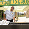 Missouri Southern Facilities Coordinator Mike Doty mans the grill during the Lions' baseball game against Pittsburg State on Wednesday at Warren Turner Field.<br /> Globe | Laurie Sisk