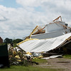 Globe/Roger Nomer<br /> Strong winds damaged Denco Aluminum in Girard on Wednesday morning.