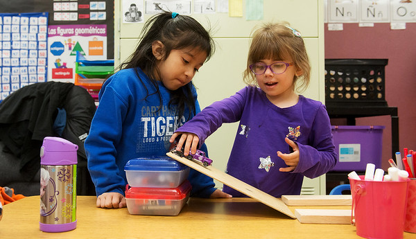 Globe/Roger Nomer<br /> Kindergartners Bella Mejia, left, and Suzanne Williams experiment with ramps during a science lesson conducted in Spanish on Monday at Fairview Elementary.